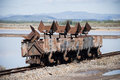 Old rusty wagons near salt ponds Royalty Free Stock Photos