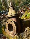 Old rusty water pipe with valve Royalty Free Stock Photo