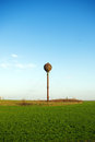 Old rusty water tower in the field Stock Photos