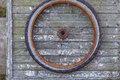 Old rusty wheel of bike on the wooden wall Royalty Free Stock Images