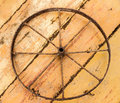 Old rusty wheel on a wooden background Stock Images