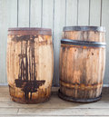 Old rusty wooden barrels in a museum used to store fish before modern methodes came to use Stock Images