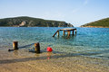 Old rusty wooden dock at sunny morning near the entrance to Porto Koufo harbor, Sithonia Royalty Free Stock Photo