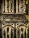 Old rusty wooden gothic door detail Stock Images