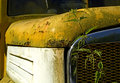 Old rusty yellow truck details of an dusty mossy and overgrown Royalty Free Stock Images