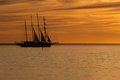 Old sail ship silhouette in sunset Royalty Free Stock Photo