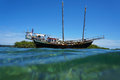 Old sailing boat stranded on a shallow reef viewed from water surface caribbean sea Royalty Free Stock Images