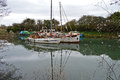 Old sailing boats in the harbour at lydney docks Stock Photos