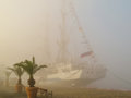 Old sailing ship in foggy day Royalty Free Stock Photo