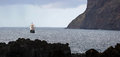 Old sailing vessel at coastline of madeira medieval is anchoring near cabo girao south coast island portugal Stock Photo
