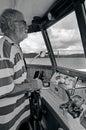 Old sailor navigating his boat Royalty Free Stock Photo