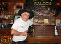 Old saloon guarding cash bartender at mammoth in goldfield arizona usa goldfield is an gold mining town located on the historic Royalty Free Stock Images