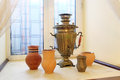 Old samovar and ceramic jugs on the windowsill Royalty Free Stock Image