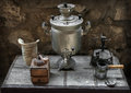 Old samovar, coffee grinder, oil lamp, coffee maker Royalty Free Stock Photo