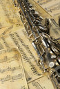 Old saxophone and notes Royalty Free Stock Images