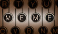Old school meme close up of typewriter keyboard with scratched chrome keys that spell out lighting and focus are centered on Royalty Free Stock Image