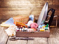 Old  scissors, various threads, iron and sewing tools Royalty Free Stock Photo