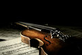 Old scratched violin in shadow music collection on music sheet vintage style Stock Image