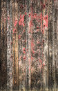 Old scratched wooden planks background with red paint texture Stock Photography