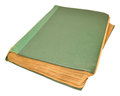 Old scruffy book an green hardback isolated on a white background Stock Photos