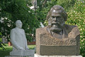 Old sculptures of karl marx and leonid brezhnev in muzeon art park fallen monument park in moscow russia june Royalty Free Stock Photography