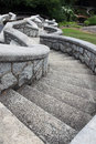 An old serpentine stone staircase in the garden Royalty Free Stock Photo