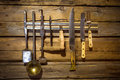 Old set of kitchenware hanging on wooden wall Royalty Free Stock Photo