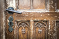 Old shabby door with metal door handle. Royalty Free Stock Photo