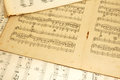 Old sheet music discoloured and tatty paper printed sheets of Royalty Free Stock Photo
