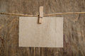 Old sheet of paper hanging on the clothesline on clothespin wood background Royalty Free Stock Photography