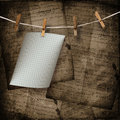 Old sheets hanging on a rope and clothespins the brown abstract background Stock Images