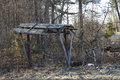 Old shelter a very and neglected for a picnic table decayed and falling down on the edge of a forest Royalty Free Stock Images