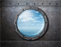 Old ship rusty porthole or window with sea and Royalty Free Stock Photo