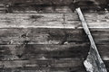 Old ship's rudder against worn wooden background Royalty Free Stock Image
