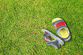 Old shoes on green grass floor Stock Photography