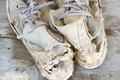 Old shoes left on the floor of the house screaming cracking. Royalty Free Stock Photo
