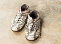 Old shoes on marble floor dirty Stock Photo