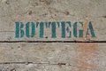 Old shop sign painted on a wooden door Royalty Free Stock Photos