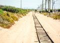 Old shore rail road in sands Royalty Free Stock Photo