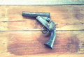 OLd short gun on the wooden board , Thailand hand made gun Royalty Free Stock Photo