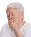 Old sick woman on a white background Stock Photo
