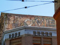 Old signs on brick wall weathering away leaving word love clearly readable. Royalty Free Stock Photo