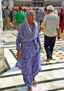 Old sikh lady in the golden temple in amritsar india it is the most sacred place of the religion and where guru nanak lived Stock Photo