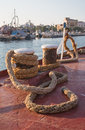 Old sisal rope of an ancient ship fixed on the docks in the harb port harbor Stock Photography