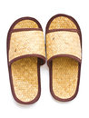 Old slippers made ​​of woven pandanus on a white background Stock Photos