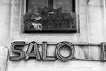 Old slots salon sign broken in black and white Royalty Free Stock Photos