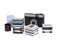 Old slr camera and plastic frames with slides isolated on white bacground Royalty Free Stock Photo