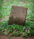 Old small gravestone among the grass Stock Image