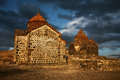 Old small stone church in armenia with dramatic sunset light and dark sky Stock Images