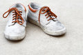 Old sneaker dirty brown on gray background Royalty Free Stock Images